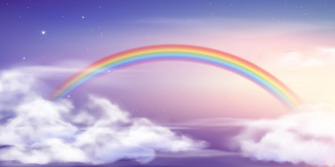 Радуга в облаках на фоне неба со звездами