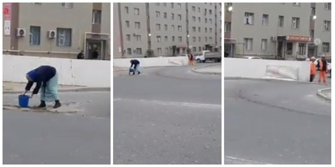 Женщина латала ямы на глазах у коммунальщиков в центре Актау (видео)