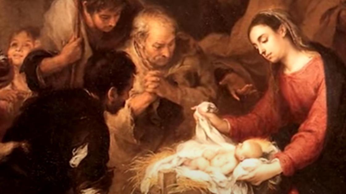 Младенец в окружении людей