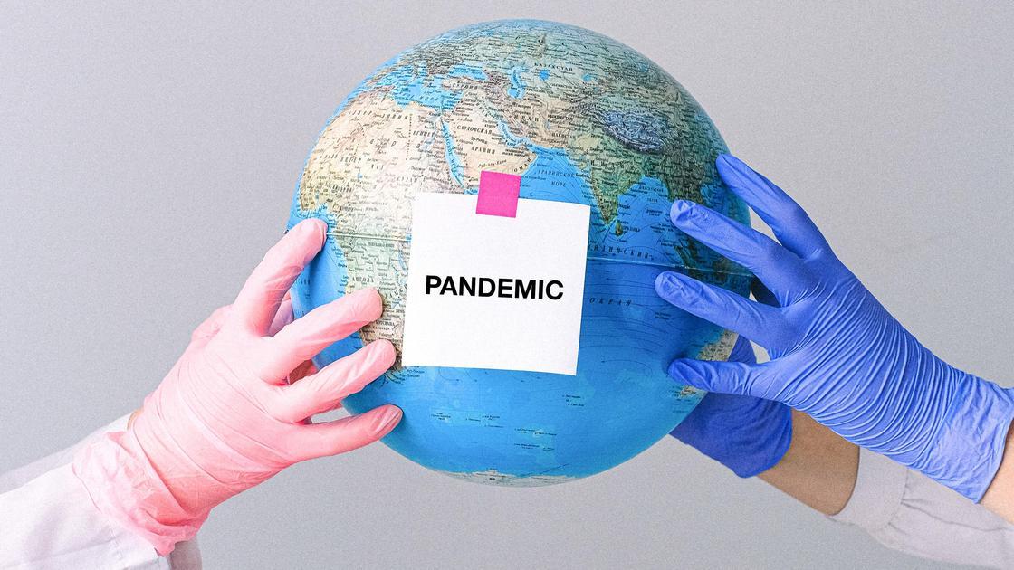 Глобус с надписью пандемия