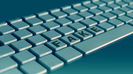 Клавиатура с надписью Fake