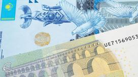 Купюра евро лежит на тенге