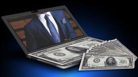 На столе ноутбук и деньги