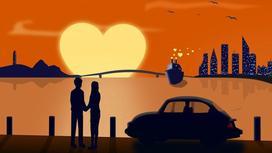 парень с девушкой смотрят на закат в форме сердца