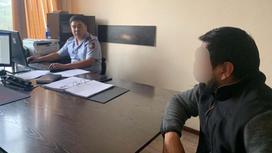 Подозреваемый на допросе в Алматинской области