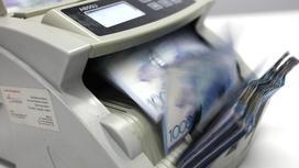 Деньги в счетной машинке