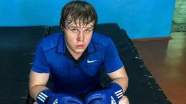 Погибший Иван Таций сидит в перчатках на тренировках