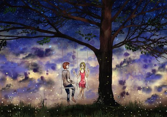 Парень и девушка на качелях ночью под деревом