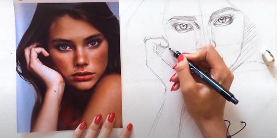 Рисуют портрет по фотографии