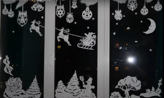 Бумажные узоры на окнах