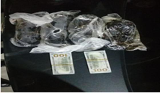 Изъятые наркотики и деньги