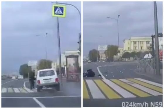 """Мужчина """"сбил"""" авто на пешеходном переходе в Санкт-Петербурге (видео)"""
