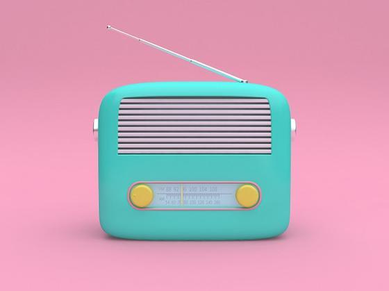 Бирюзовое радио на розовом фоне