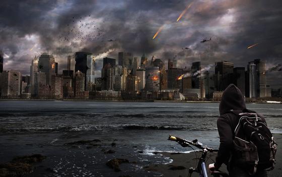 Юноша смотрит на разрушенные и горящие здания