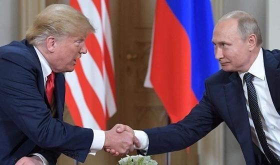 Трамп и Путин пожали друг другу руки в Париже (видео)