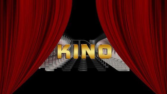 Надпись «Кино» на фоне зрительного зала