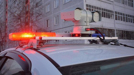 Полицейский автомобиль с мигалками