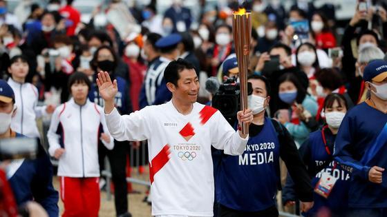 Олимпийский огонь в Токио