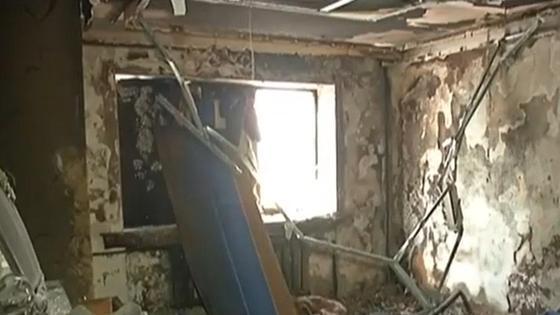 Разрушенная пожаром квартира в Караганде